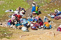 High angle view of a group of women washing clothes, Puno, Cuzco, Peru