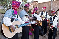 Five guitarists performing, Lake Titicaca, Taquile Island, Puno, Peru