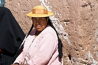 Portrait of a mid adult woman taking part in a wedding ceremony, Taquile Island, Lake Titicaca, Puno, Peru
