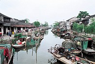 Houses by river, Black Roof Boat in Xitang Town, Jiaxing City, Zhejiang Province, People's Republic of China
