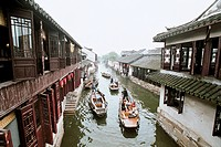 Elevated view of boats traveling in canal, Tongli Town, Wujiang City, Jiangsu Province of People´s Republic of China, FOR EDITORIAL USE ONLY