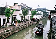 Tourists traveling on a boat in canal, Wuzhen Town, Tongxiang City, Zhejiang Province, People´s Republic of China, FOR EDITORIAL USE ONLY