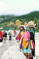 Vendors in traditional clothing selling clothes on road, The Zang nationality people in Jiuzhaigou scenic area , Nanping County, Aba State, Sichuan Pr...
