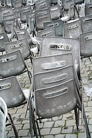 Grey stacking chairs at the Vatican, Rome, Italy