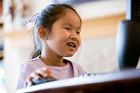 Young Asian giirl using computer