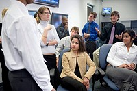 Group of young office workers together in meeting