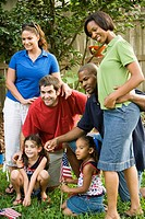 Two families standing on the lawn on 4th of July