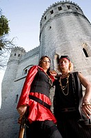 Portrait of armed pirates standing outside a castle