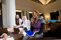 Portrait of four women students in a sitting lounge in a library