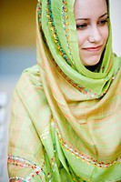 Close_up of a smiling young woman wearing a head scarf