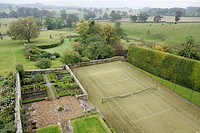 UK. England, Northumberland, Colridge, Halton Castle 1382. Pele tower view: garden and tennis court.