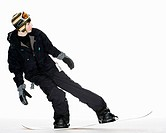 Teenage boy snowboarding