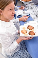 Girl with potato latkes
