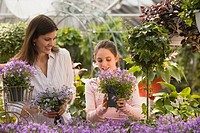 Mother and daughter at greenhouse