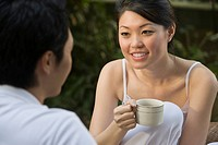 Smiling woman chatting over tea