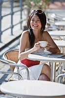 Smiling woman at outdoor cafe