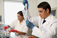 Scientists working with test tubes in lab