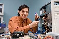 Computer technician repairing computer