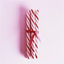 Peppermint candy canes wrapped with ribbon