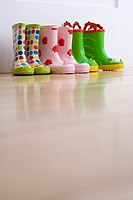 Three pairs of children's rubber boots, ground view