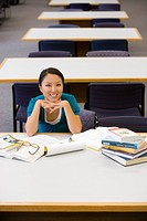 Young woman studying in library, smiling, portrait, elevated view