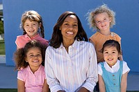 Teacher and children 3-7, smiling, portrait