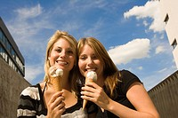Happy young women with ice cream cones (thumbnail)