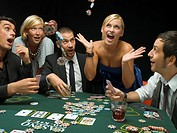 Happy woman throwing poker chips at poker game (thumbnail)