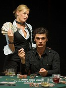 Couple at poker game holding money