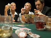 Woman kissing dealer button at poker game