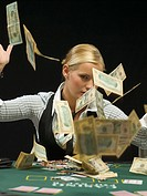 Woman throwing cash at poker game