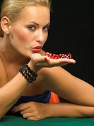 Woman blowing on dice