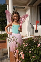 Portrait of young fairy girl at home