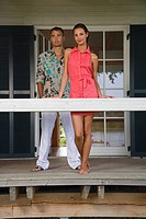 Young couple standing on porch