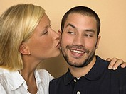 Woman kissing man on his cheek (thumbnail)