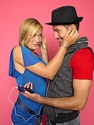 Young couple listening to earphones