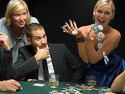 Happy woman throwing poker chips at poker game