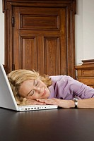 Businesswoman asleep with her laptop