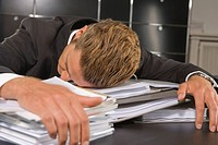 Businessman sleeping in an office