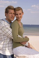 Portrait of young couple at the beach