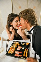 Young couple sharing food (thumbnail)