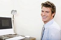 Businessman next to computer