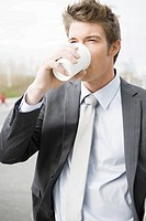 Businessman drinking take out coffee