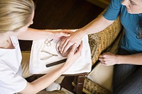 Woman performing spa manicure
