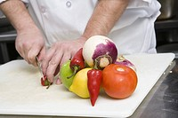 Chef chopping vegetables (thumbnail)