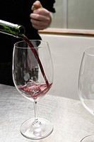 Close up of wine pouring into glass (thumbnail)