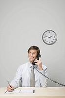Businessman talking on telephone (thumbnail)