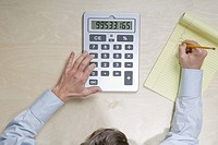 Businessman using calculator