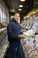 Man at newspaper stand