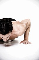 Bare-chested man doing push-ups